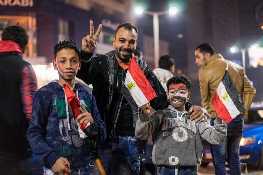 משפחה מצרית בזמן המשחקים באליפות אפריקה (צילום: Mark Fischer/CC 2.0)