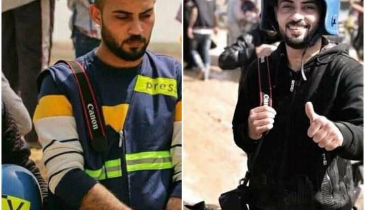 העיתונאי אחמד אבו חוסיין בעבודתו בעזה