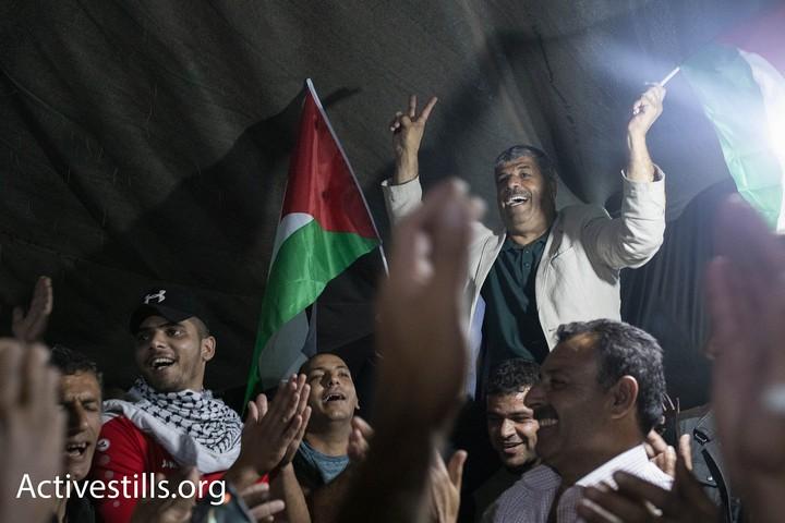 """החגיגות בח'אן אל אחמר. """"לא ישנו כבר כמה חודשים"""" מספרים התושבים (צילום: אורן זיו / אקטיבסטילס)"""