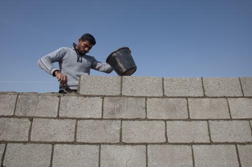"""פועל בעזה. צילום: אימאן מוחמד, עבור """"גישה"""""""