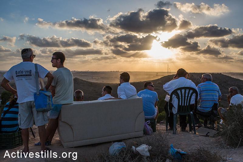 עזה מהצד הישראלי על רקע השקיעה, 2014. אורן זיו/אקטיבסטילס