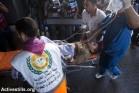 ילד פצוע מובהל לבית החולים אל-שיפא, 24 ביולי 2014 (אן פאק/אקטיבסטילס)