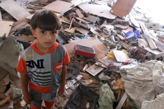 מחמד אבו ג'ארד, בן 10, שאיבד את הוריו, אחיו ואחותו (עאוני פרחאת)
