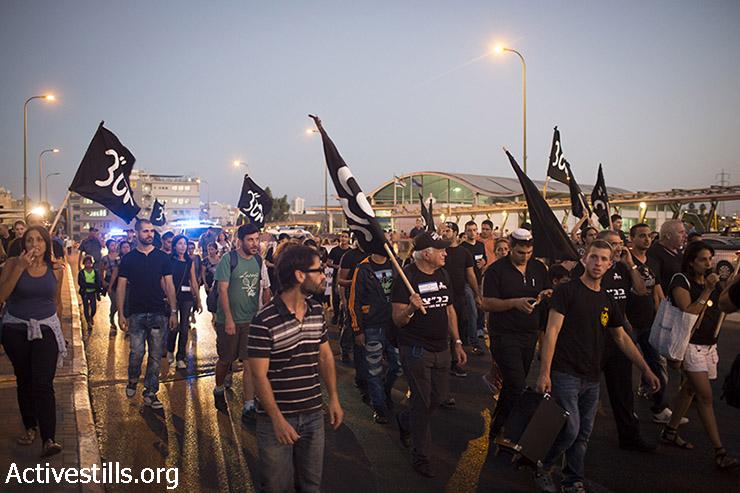המפגינים צועדים ברחובות דרום תל אביב. (אורן זיו/אקטיבסטילס)