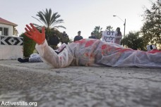 מחאה נגד עופרת יצוקה בבסיס שדה דב (אורן זיו / אקטיבסטילס)