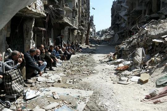 """פליטים פלסטינים במחנה אל-ירמוכ בסוריה (צילום: Walla Masoud, אונר""""א)"""