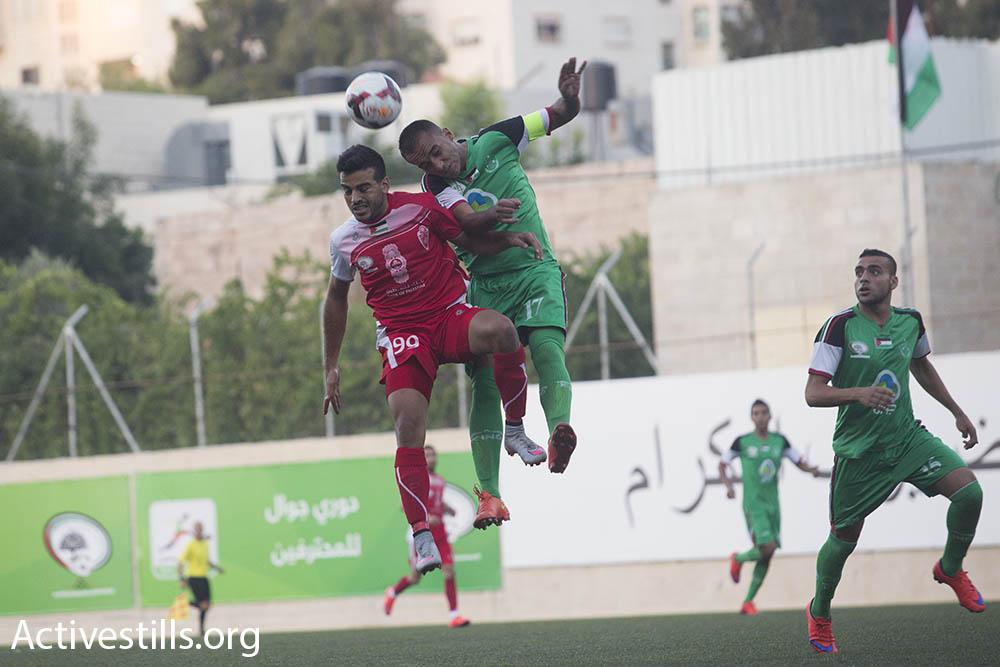 אל-אהלי חברון (אדום) מול איתיחאד שג'אעיה (ירוק) (אורן זיו / אקטיבסטילס)