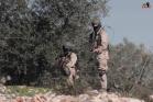 חיילים חמושים במדים אמריקאים לוקחים חלק בירי על מפגינים בכפר קדום. הגדה המערבית 20 בנובמבר 2015 (צילום: רפעת אלקדומי)