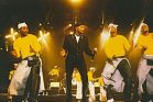 קופי אולומידה בהופעה בשנת 2000 (dicap ipups CC BY 2.0)