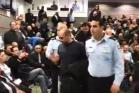 """יגאל רמג""""ם מפונה מהאירוע לחנוכת תחנתהמשטרה ביפו לאחר שצעק לעבר השר ארדן (צילום מסך מסרטון של רוטר.נט)"""