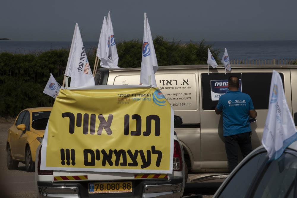 מחאת העצמאיים בתל אביב, בהתארגנות ליאצה בשיירה לכנסת, 30 במרץ 2020 (צילום: אורן זיו)