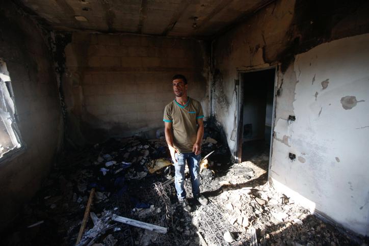 ההרשעה של בן אוליאל החזירה את מועקת הימים ההם. צעיר בחדר השרוף של משפחת דוואבשה בדומא (צילום: הייתאם שתאיה / פלאש 90)