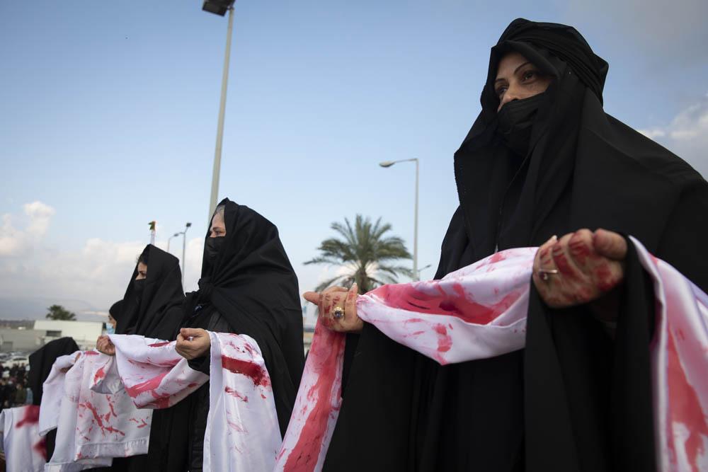 פוראת נאסר היה צריך להסביר שהערבים רוצים לחיות. הפגנה במחאה על הירי באחמד חיג'אזי בטמרה (צילום: אורן זיו)