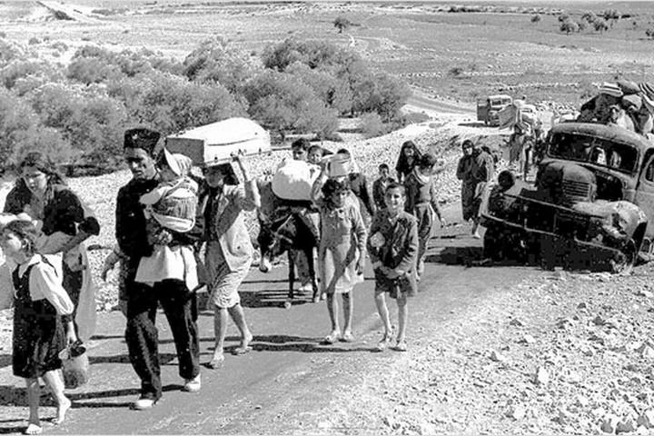 פליטים פלסטינים בורחים מהגליל באוקטובר-נובמבר 1948 (צילום: Fred Csasznik, public domain)