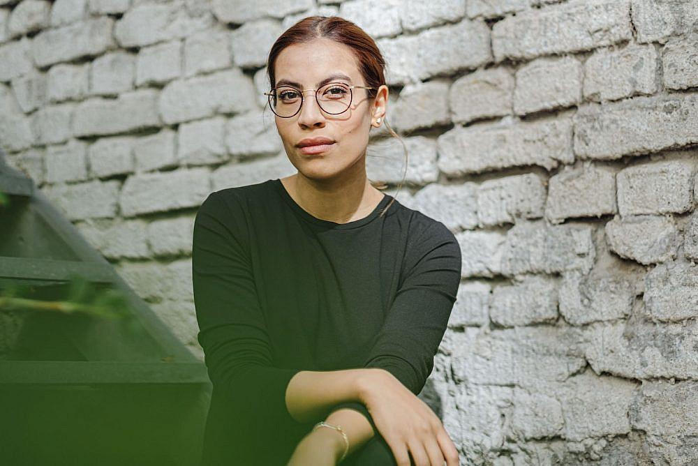 התקשורת הגרמנית העדיפה להציג אותה עם חיג'אב. העיתונאית נמי אל-חסן (צילום: פול אלכסנדר פרובסט)